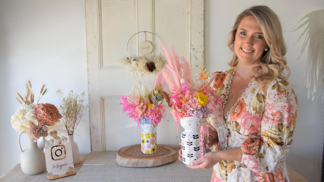 Selena Sheppard with a display of her dried flower arrangements for her new business, Foreverstill Blooms.