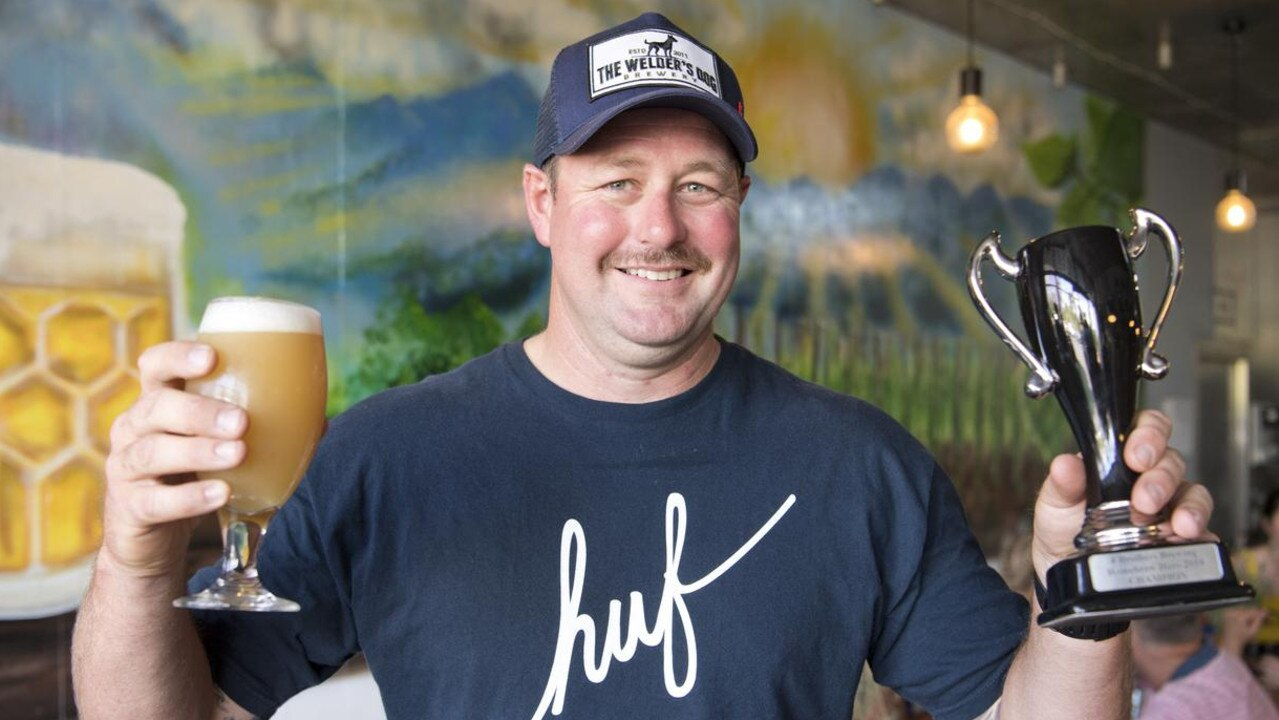 CHEERS: Tony Brand with his Four Fires Pale Ale at the Homebrew Heroes brewing competition in Toowoomba. Picture Picture: Nev Madsen. .
