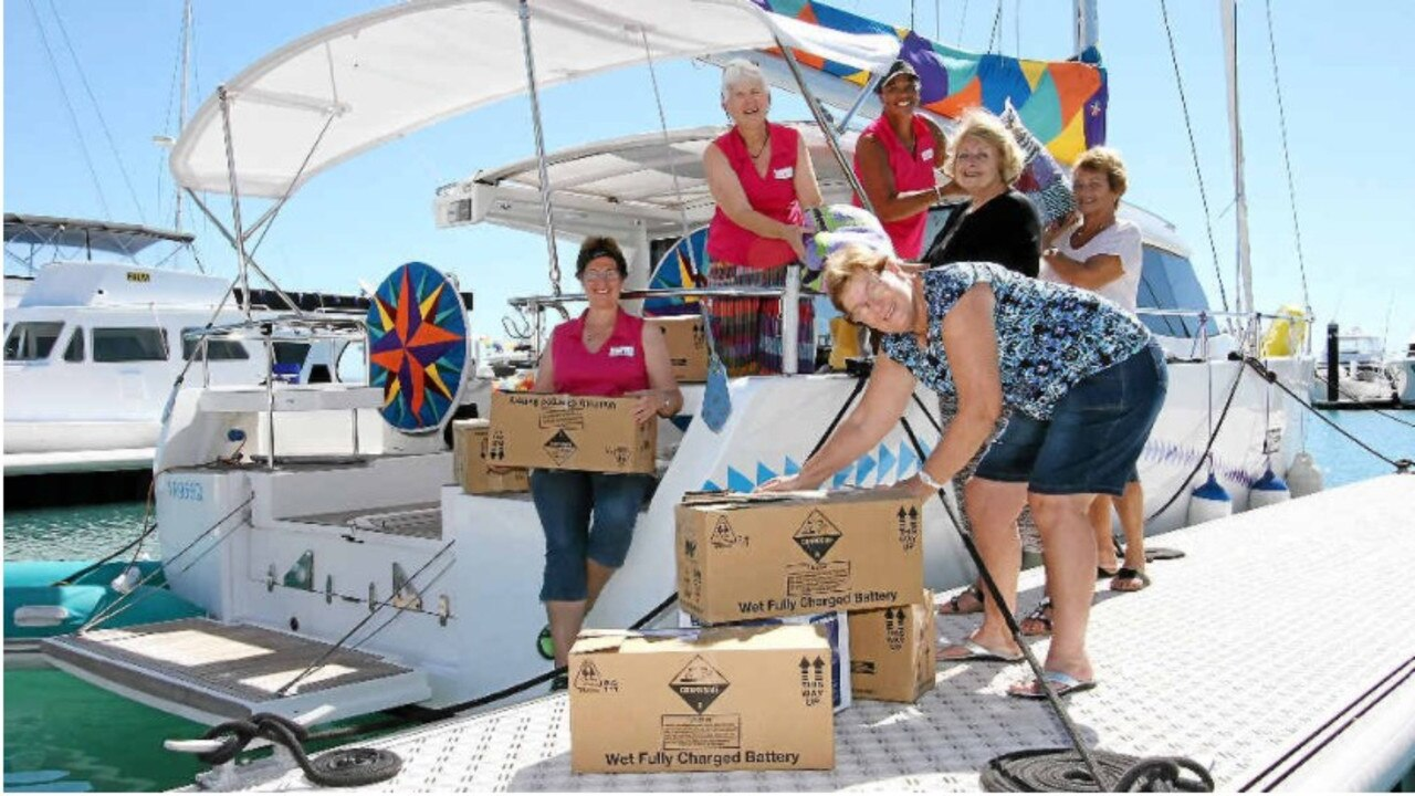 La Quilta crew Sandy Pavey, Heather Sutton and Iseta Harris load up with goods for their Vanuatu voyage courtesy of Zonta Whitsunday members Dawn Green, Carole Lindsay and Judy Brown in 2014. Photo: Sharon Smallwood