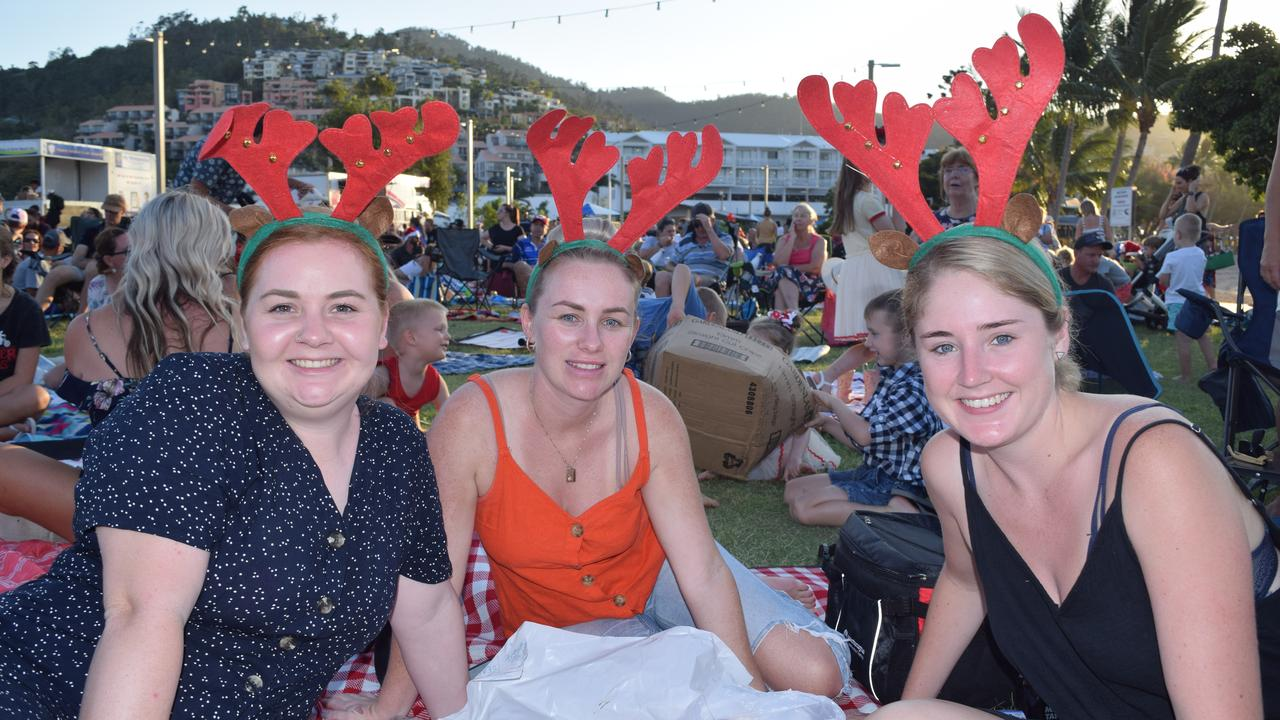 (From left) Meghan Gibson, Laura Goff and Tabitha Field at the Rotary Carols by the Beach 2019 on the Airlie Foreshore. Picture: Elyse Wurm