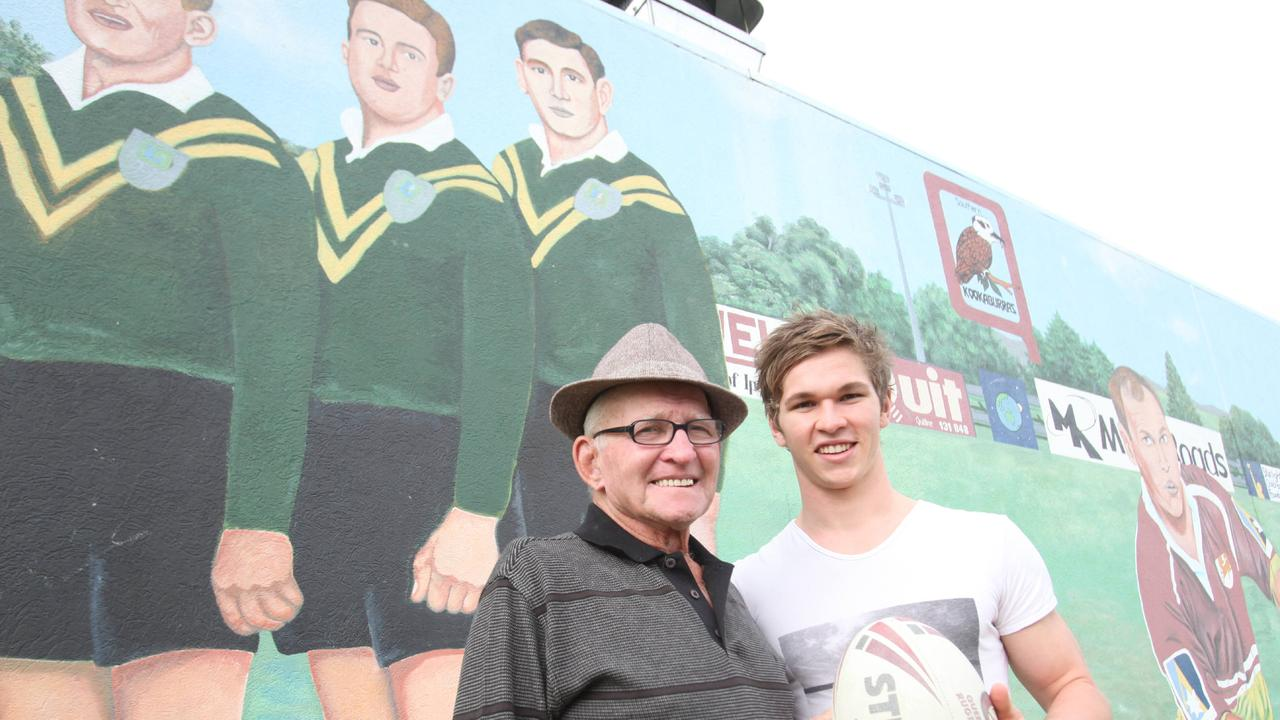 Former Australian rugby league great Gary Parcell with his grandson Matt at the North Ipswich Reserve where Gary was painted with his Ipswich and national teammates Dud Beattie and Noel Kelly.