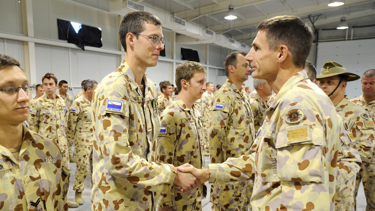 Major General Angus Campbell with soldiers at Al Minhad Air Base, UAE. Picture: Australian Defence Force