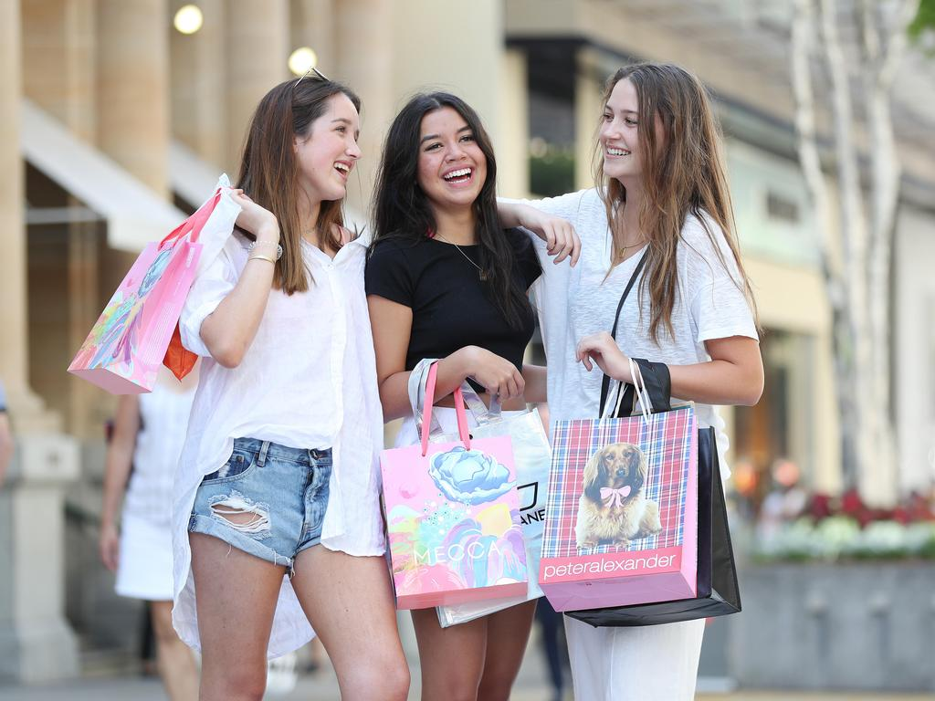 Lily Carey, 17, Izzy Byrne, 17, and Ella Blanck, 17, shopping in Queen Street Mall. Picture: Tara Croser