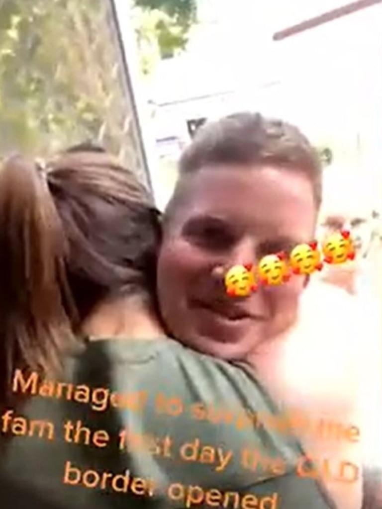Journalist Mitchell Van Homrigh gives his big sister a hug.