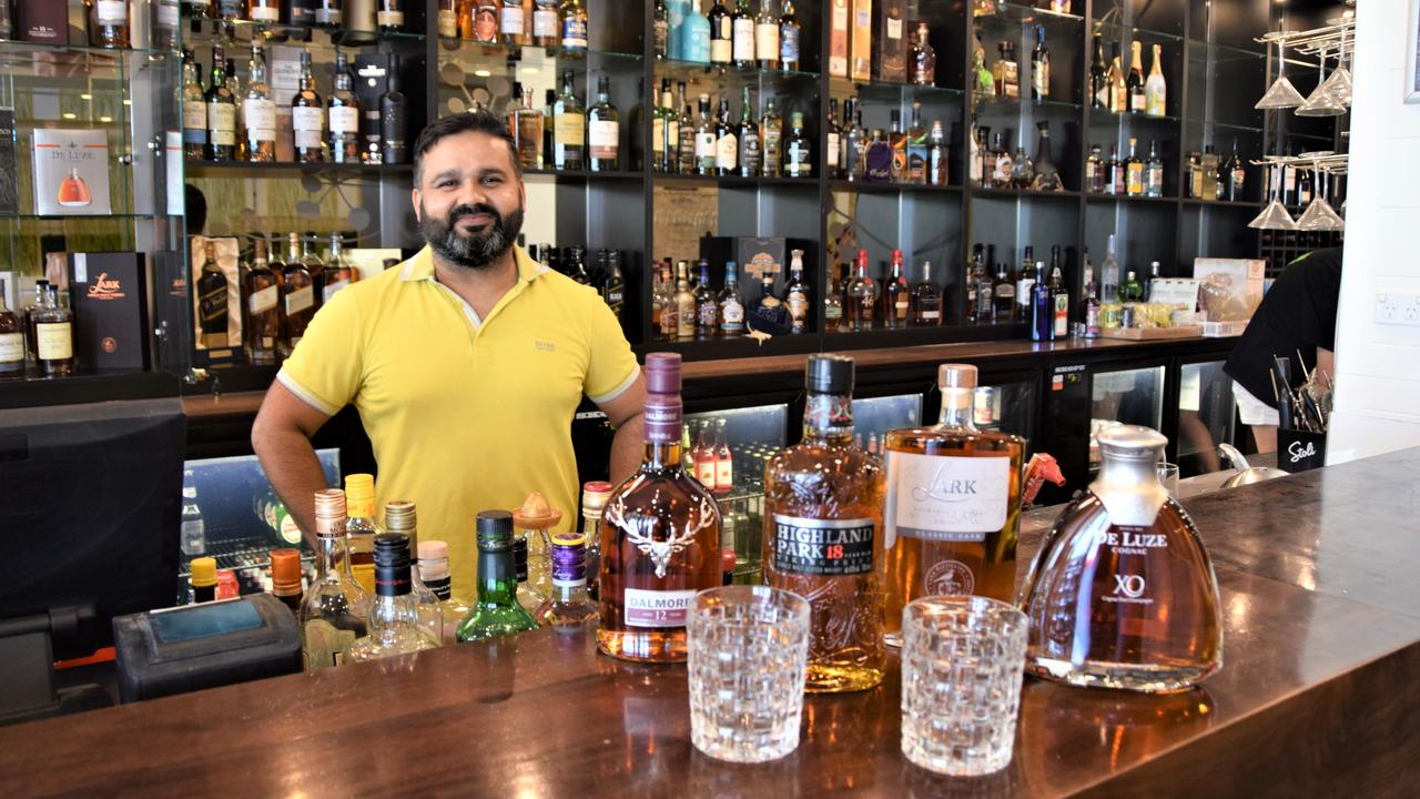 Amit Rana with some of the bottles from the top shelf whiskey collection at his venue at The Edge Apartment Hotel, restaurant TruFusion.