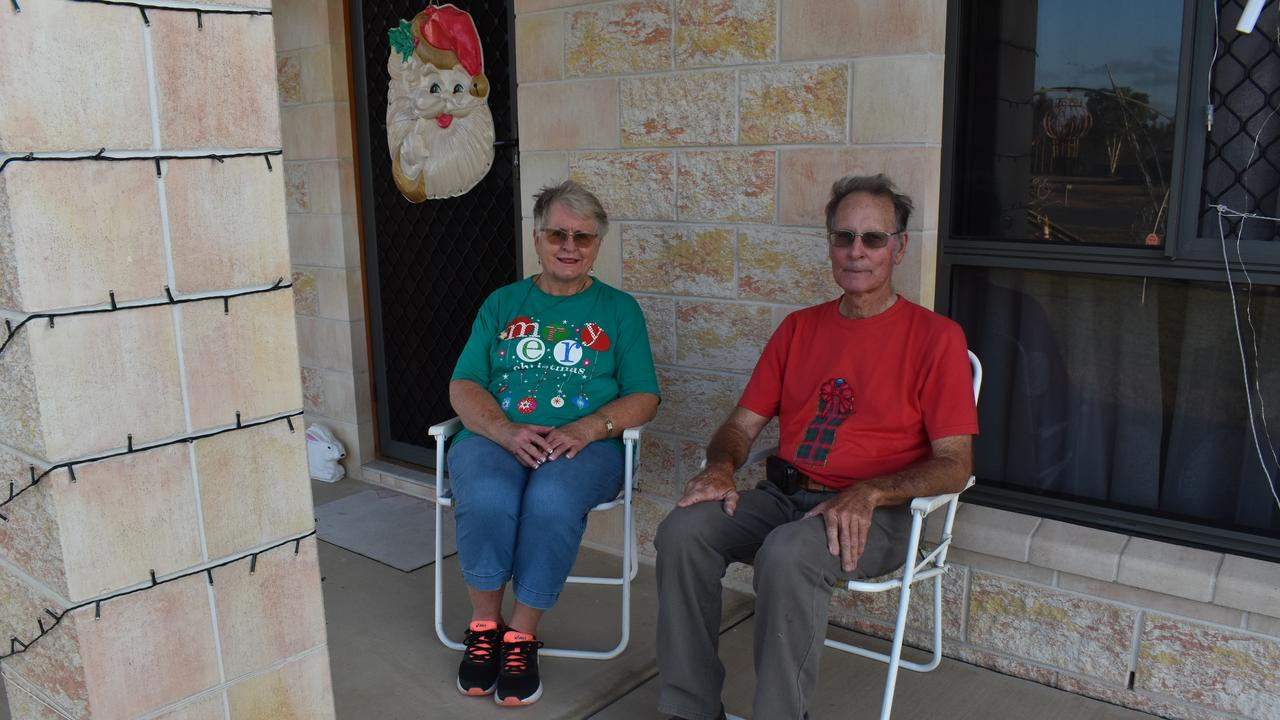Husband and wife Kathy and Ray Brecknell sit on fold-up chairs at their front door every night, as visitors admire their light display. Picture: Rhylea Millar