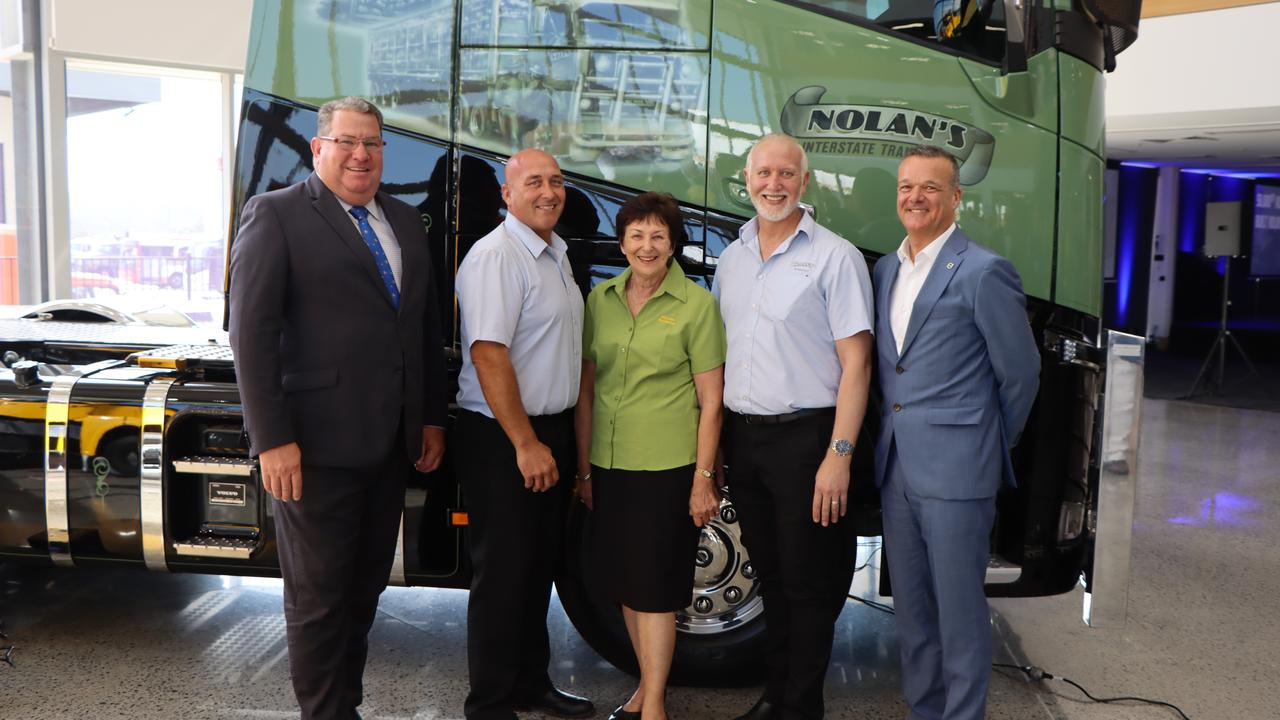 Scott Buchholz MP (left) with members of the Nolan family as they take ownership of Volvo's 50,000th vehicle manufactured at Wacol.