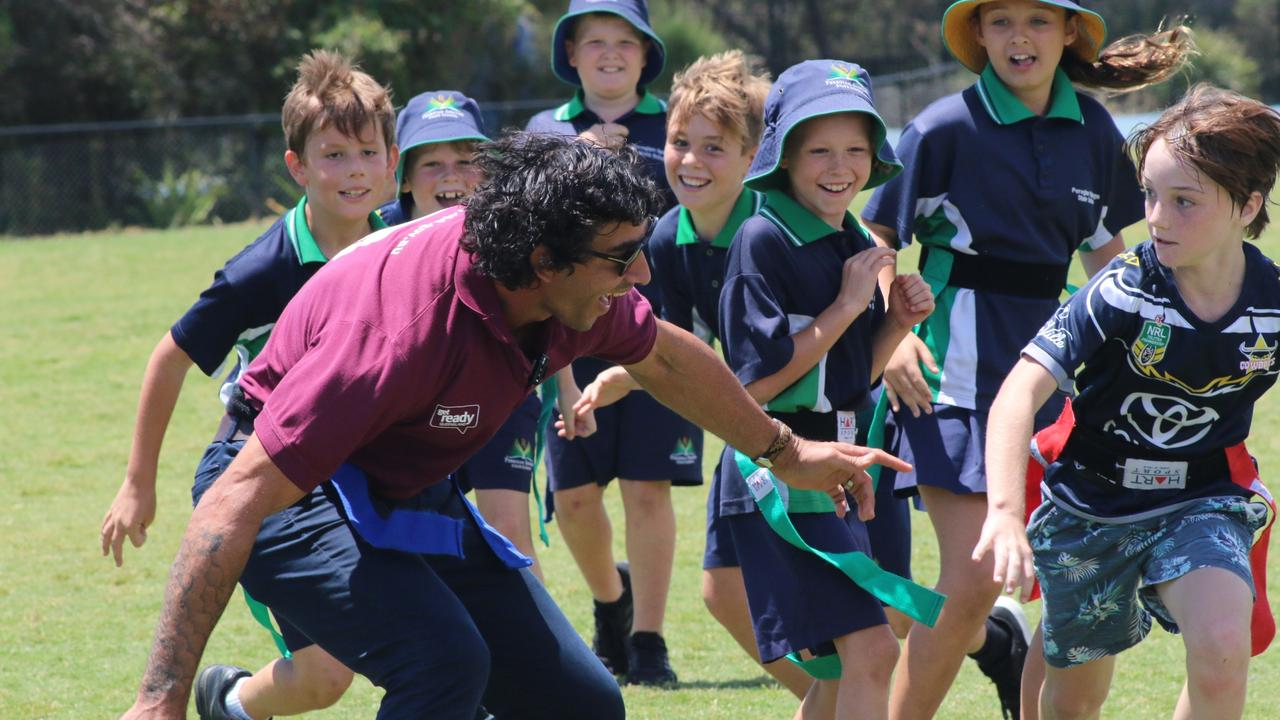 Peregian Springs State School student Cobey Browne tries to tag rugby league legend Johnathan Thurston during a visit to the school on Thursday. Picture: Tom Threadingham