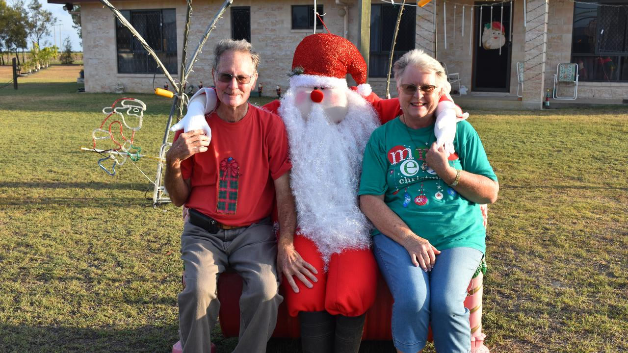 Christmas light enthusiasts Kathy and Ray Brecknell with the Santa they made using cloth fabric and beanbags. Picture: Rhylea Millar