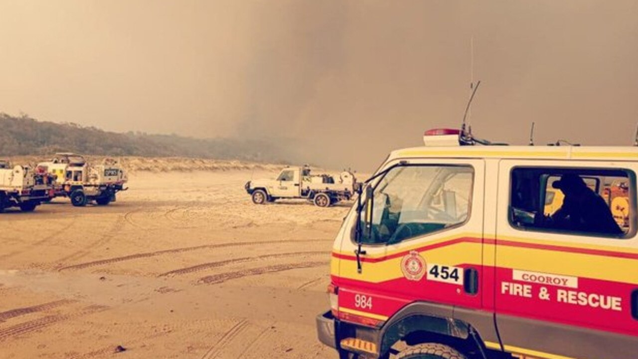 Firefighting units gather on the beach during the Fraser Island bushfires.