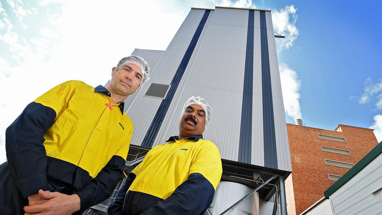 Richard Jones and Maran Arumuga at the Nestle Gympie factory.