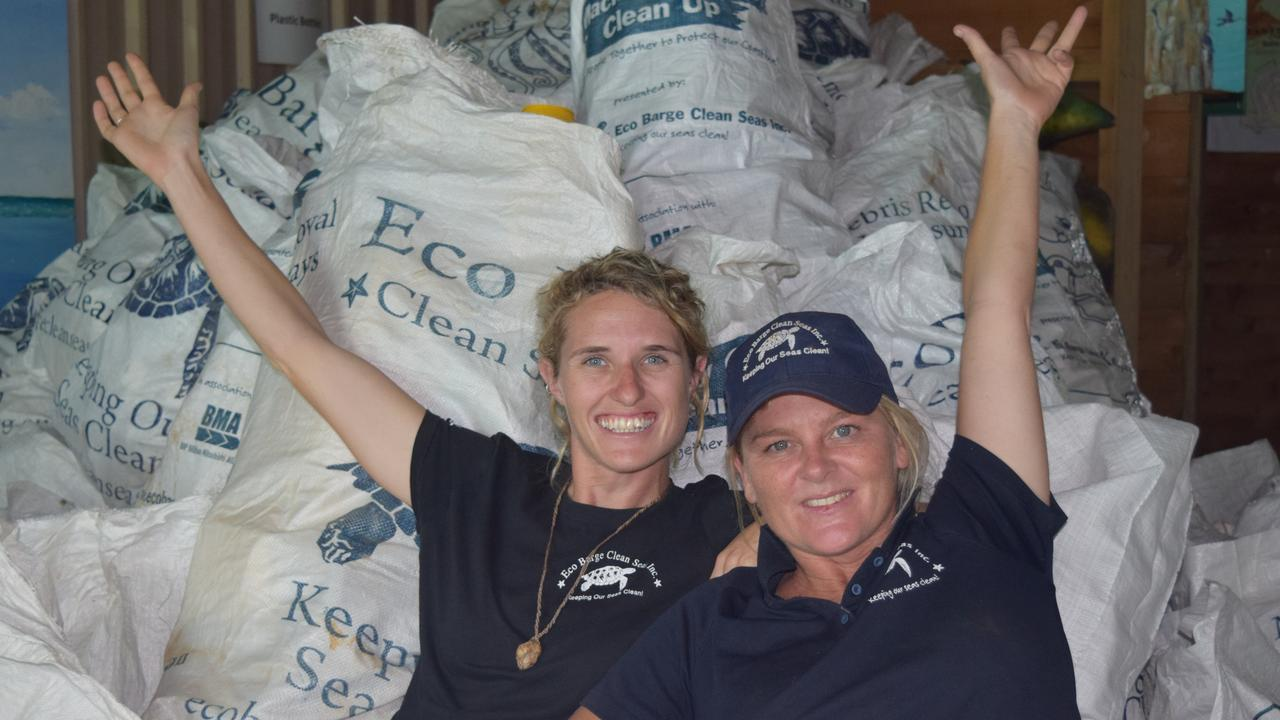 Eco Barge Clean Seas project coordinator Fiona Broadbent and Founding chairperson Libby Edge with some of the many bags of plastic bottles collected from Whitsunday beaches.