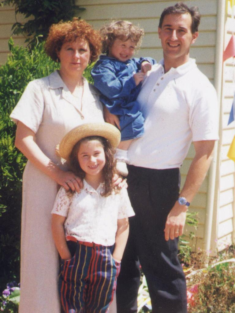 Walter Mikac and family in front of Walter Mikac's Tasman Pharmacy at Nubeena. Picture: Supplied