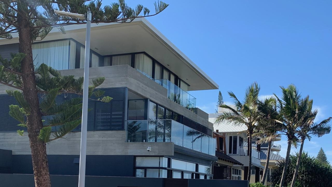 The house is a few steps from the wide sands of Mermaid and Nobby's beaches.