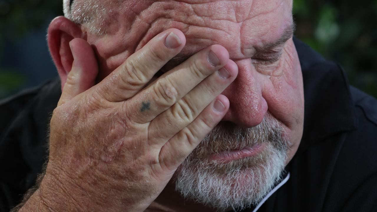 Brett Beasley wipes away a tear while talking about his son. Picture: Glenn Hampson.