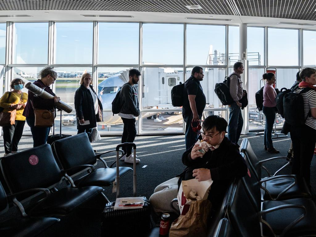 Passengers waiting to board a Jetstar flight at Sydney Airport. Picture: Image/James Gourley)
