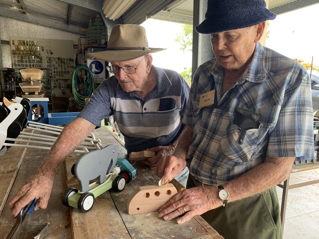 Bill Seymour, 91, and Kevin Windsor, 88, have created more than 1000 toys for Mackay foster children at the Beaconsfield Road Men's Shed. Picture: Heidi Petith