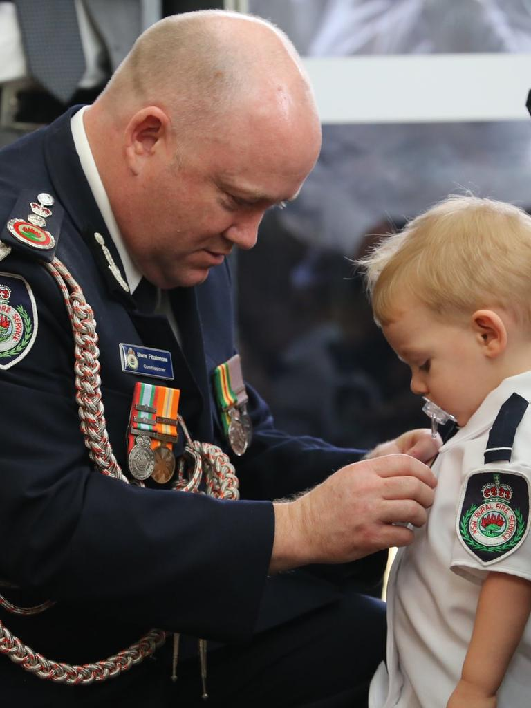 Former Commissioner Fitzsimmons pins medal on Harvey. Picture: RFS NSW