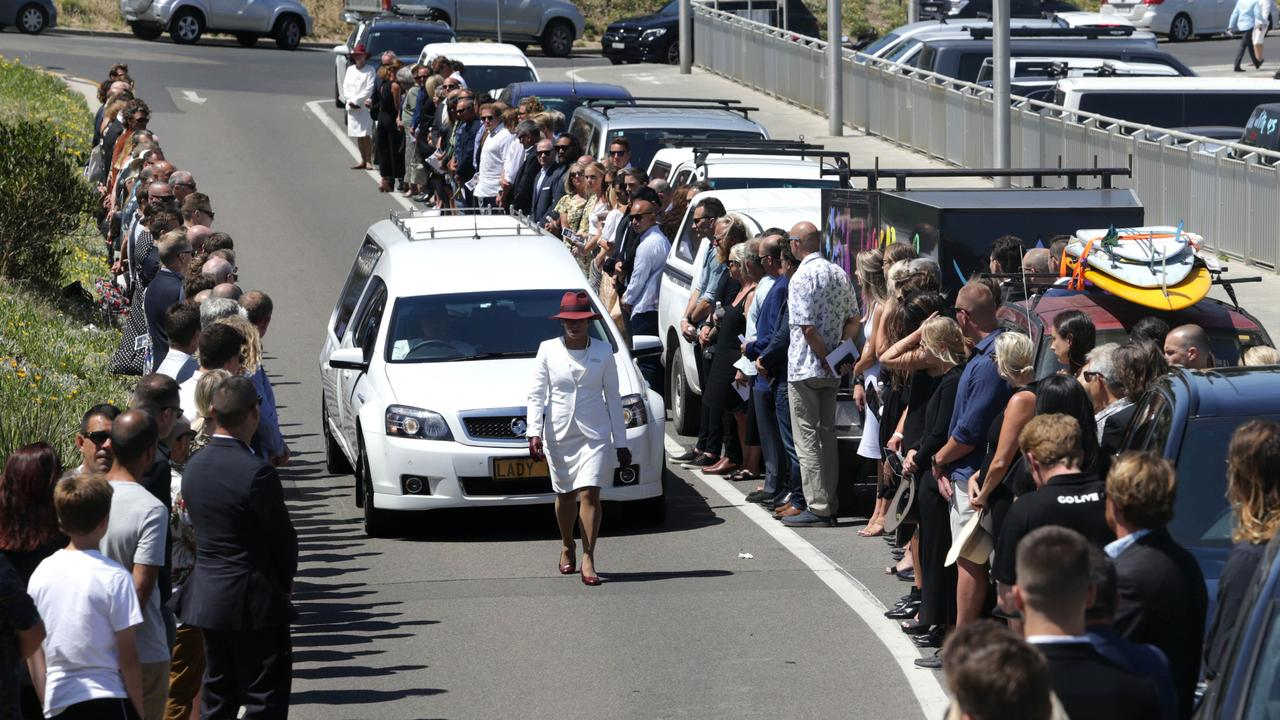 Mourners line the road to Wanda Surf Club on Tuesday. Picture: John Veage on behalf Surfing NSW