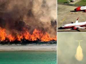 Town evacuated as super tankers attack Fraser Island fire