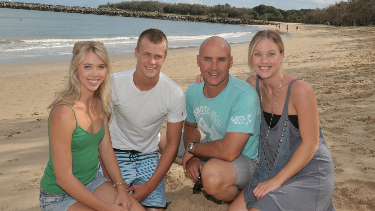 Grant Kenny with his children Jett, Morgan and Jaimi on Mooloolaba Beach. Picture: John McCutcheon