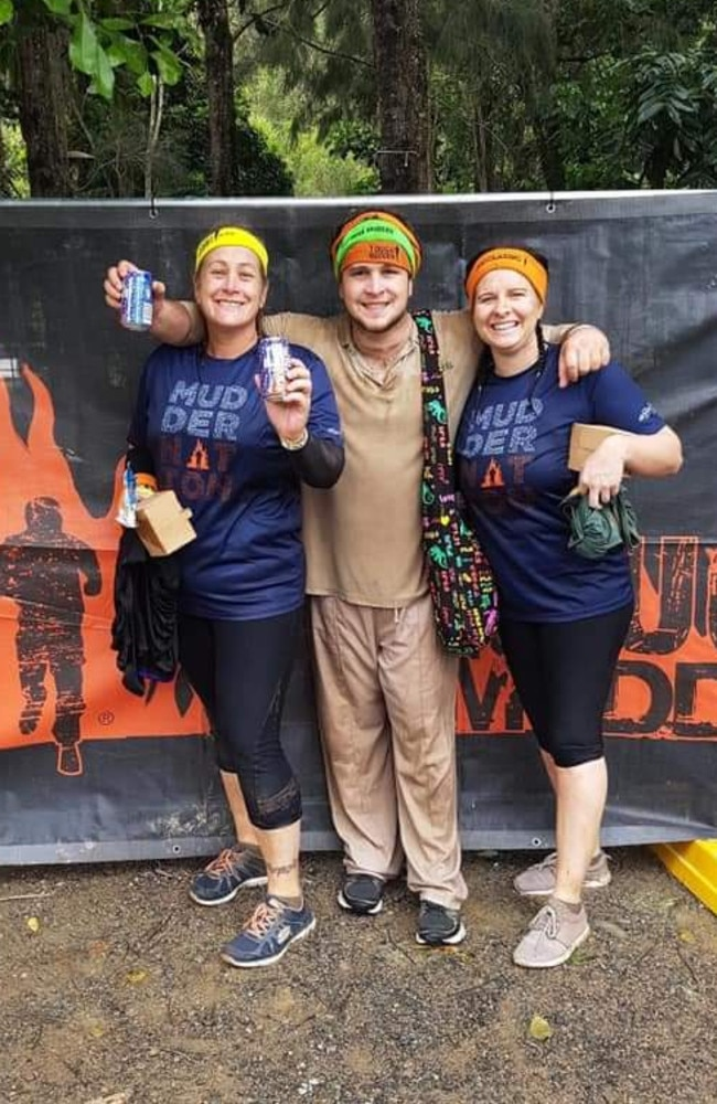 Bradley Homan (centre) wearing his not-so-white Tough Mudder outfit, with his mum Kerri Barbeler and sister-in-law Clerissa Barbeler. Picture: Supplied
