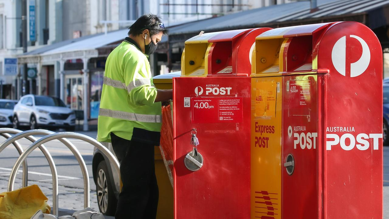 Australia Post charges $12.45 for a medium package. Picture: NCA/NewsWire/Ian Currie