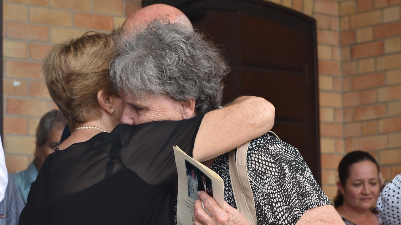 Fellow mourners comforted Win Manning at her husband's funeral. More than 200 people farewelled former Daily Mercury editor Rod Manning at St Patrick's Catholic Church, Mackay, on Tuesday December 8. Picture: Zizi Averill