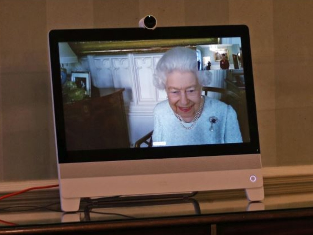 The Queen speaks via Zoom to diplomats visiting Buckingham Palace. In the far left corner, a never before seen photo of Prince George and Princess Charlotte is featured. Picture: Supplied