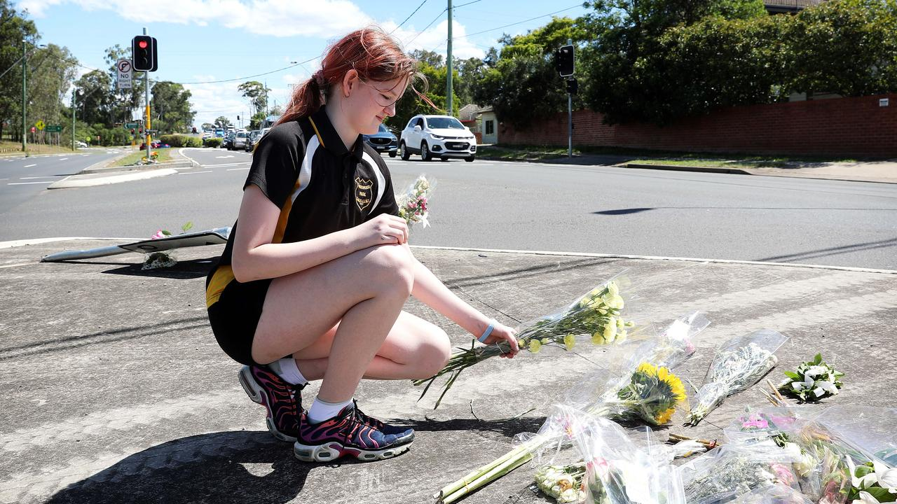 Friend Alyssa Dransfield 12, leaving flowers at the scene. Picture: Tim Hunter