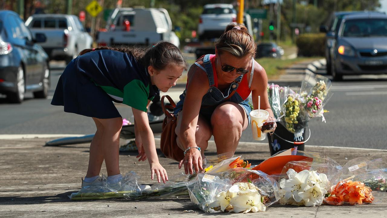 Nicole and Taliah Connor leaving flowers at the site of the accident. Picture: Justin Lloyd.