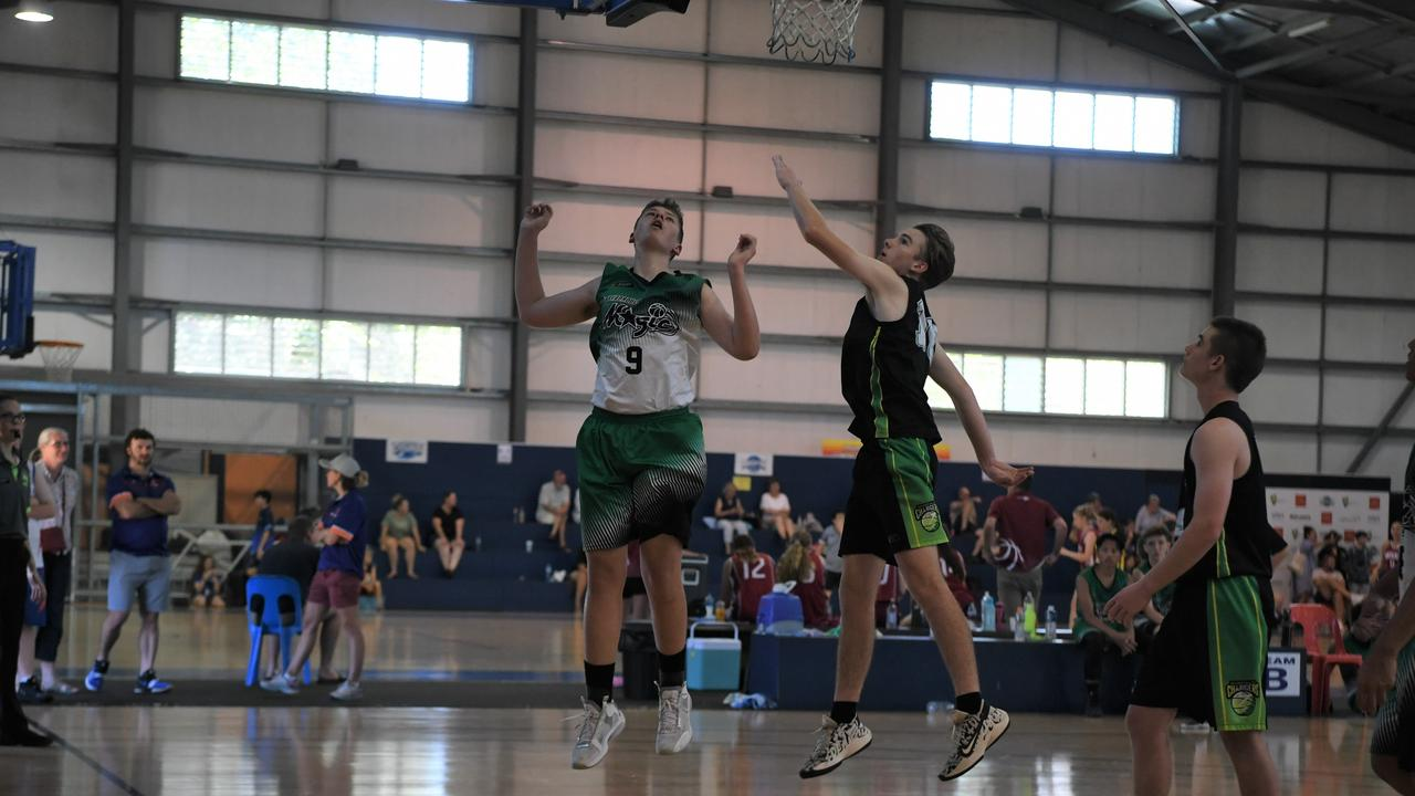 U18 Boys 2 Emerald Chargers player B. Morton and Maryborough Magic player C Harrison shoot for the ball at the hoop in the CQJBC at Rockhampton's Hegvold Stadium on Sunday.
