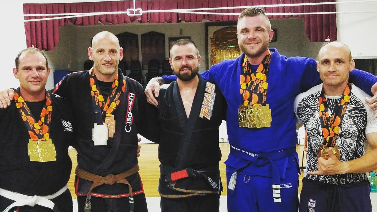 Drop Bear Brazilian Jui-Jitsu Club medal winners with instructor Dave Vass-Bowen. Pictured are (from left): Mark Harvey, Eric Glouftsis, Dave Vass-Bowen, Nicholas Currell and Michael Cox.