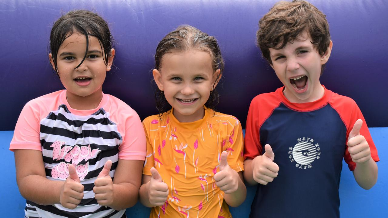Year 1 students Shanaye Doak, Brylee Sherlock and Elijah Branchett enjoying the water slides as part of Fitzgerald State School's break-up activities to end the 2020 school year. Picture: Heidi Petith