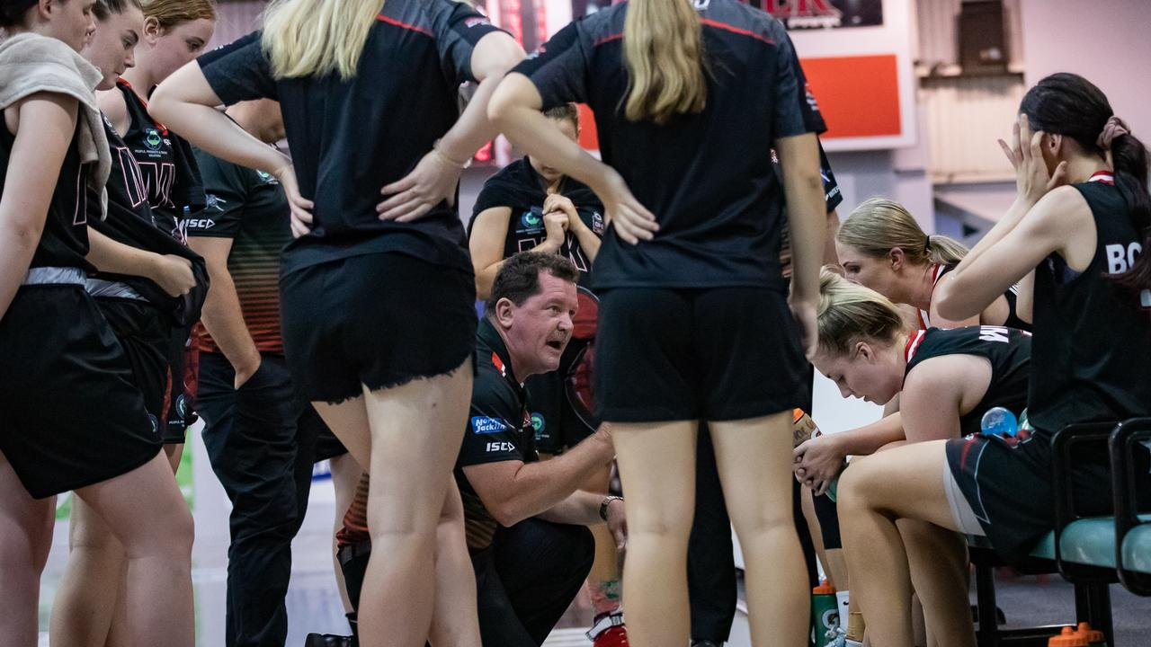Scott Mckenzie (middle, crouched) has been appointed the Mackay Meteorettes 2021 NBL1 North coach after leading the team on an unbeaten ConocoPhillips CQ Cup campaign. Photo: Trudi Jensen