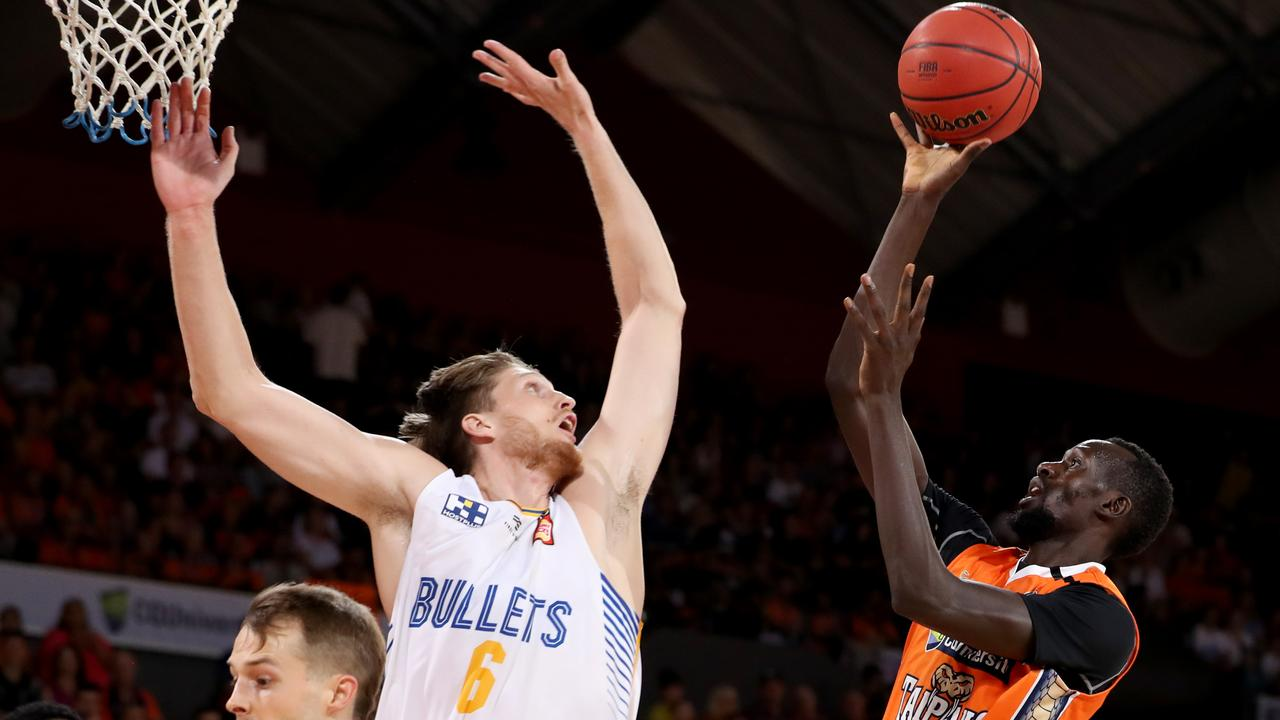 Brisbane Bullets player Matt Hodgson rises to block a shot in an NBL match against Cairns Taipans before the COVID sporting shutdown. Picture: Marc McCormack/AAP Image