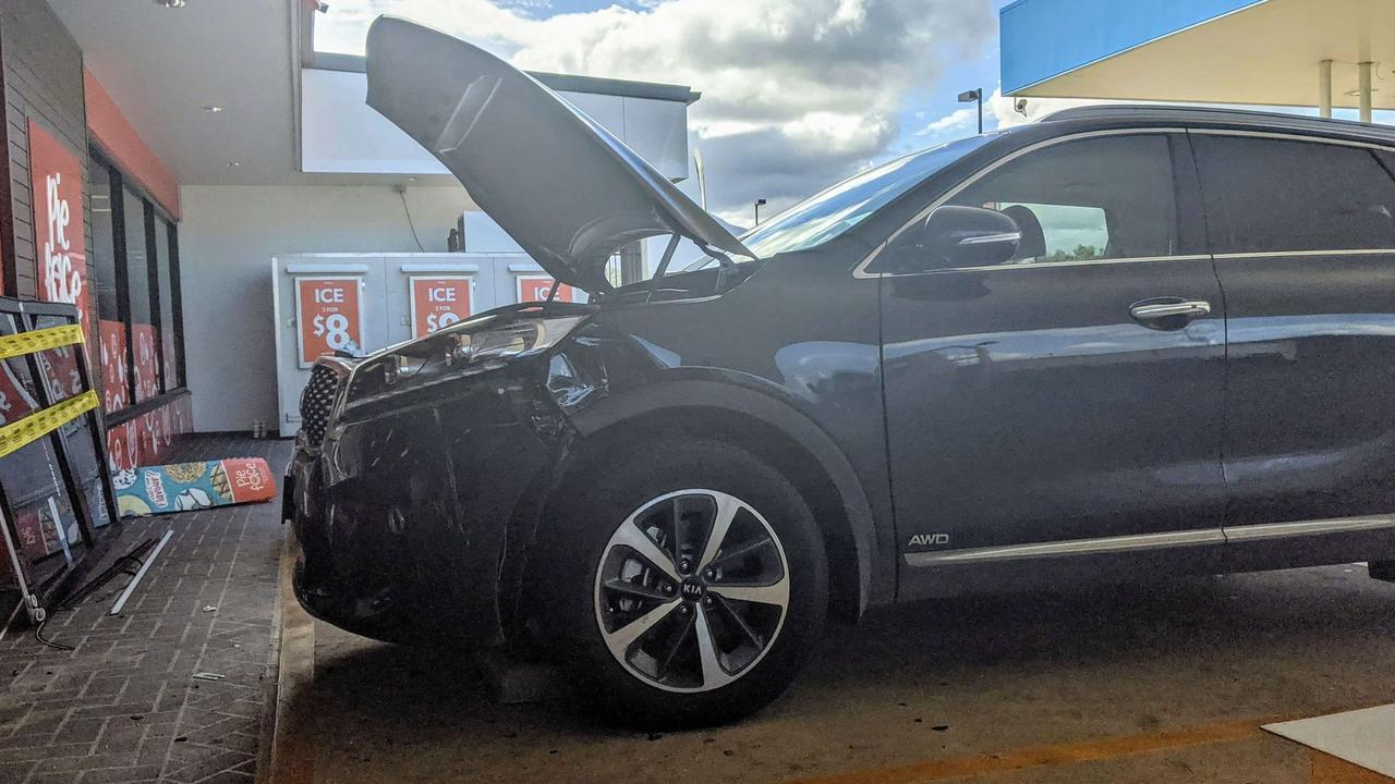 Paramedics and police on scene after a car smashed into the United service station on Cairns St at Gordonvale. PICTURE: TOBY VUE