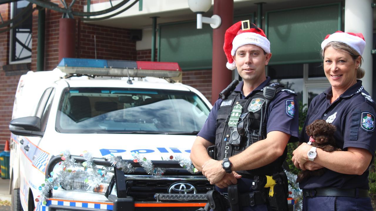 HAPPY HOLIDAYS: Senior Constables Rob Bradley and Melinda Bardini, and little Vera urge the community to have a safe festive season.
