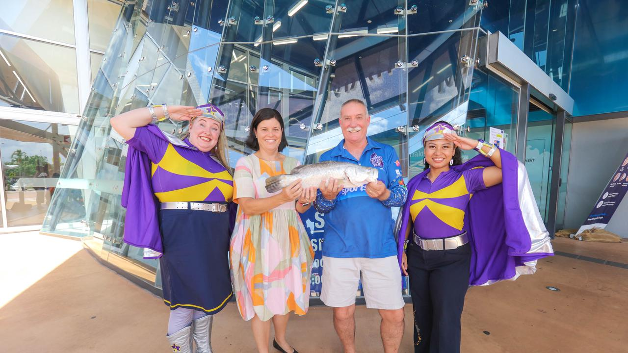 Tony McLean with Minister Natasha Fyles and Captains Starlight. Picture: Glenn Campbell