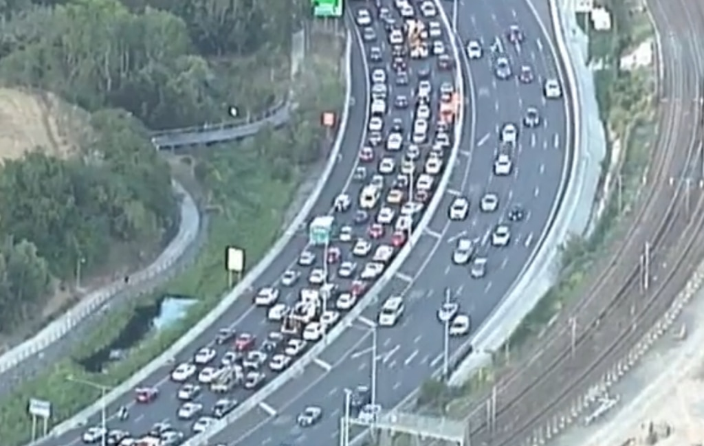 Traffic chaos on the Pacific Motorway following a four-car prang