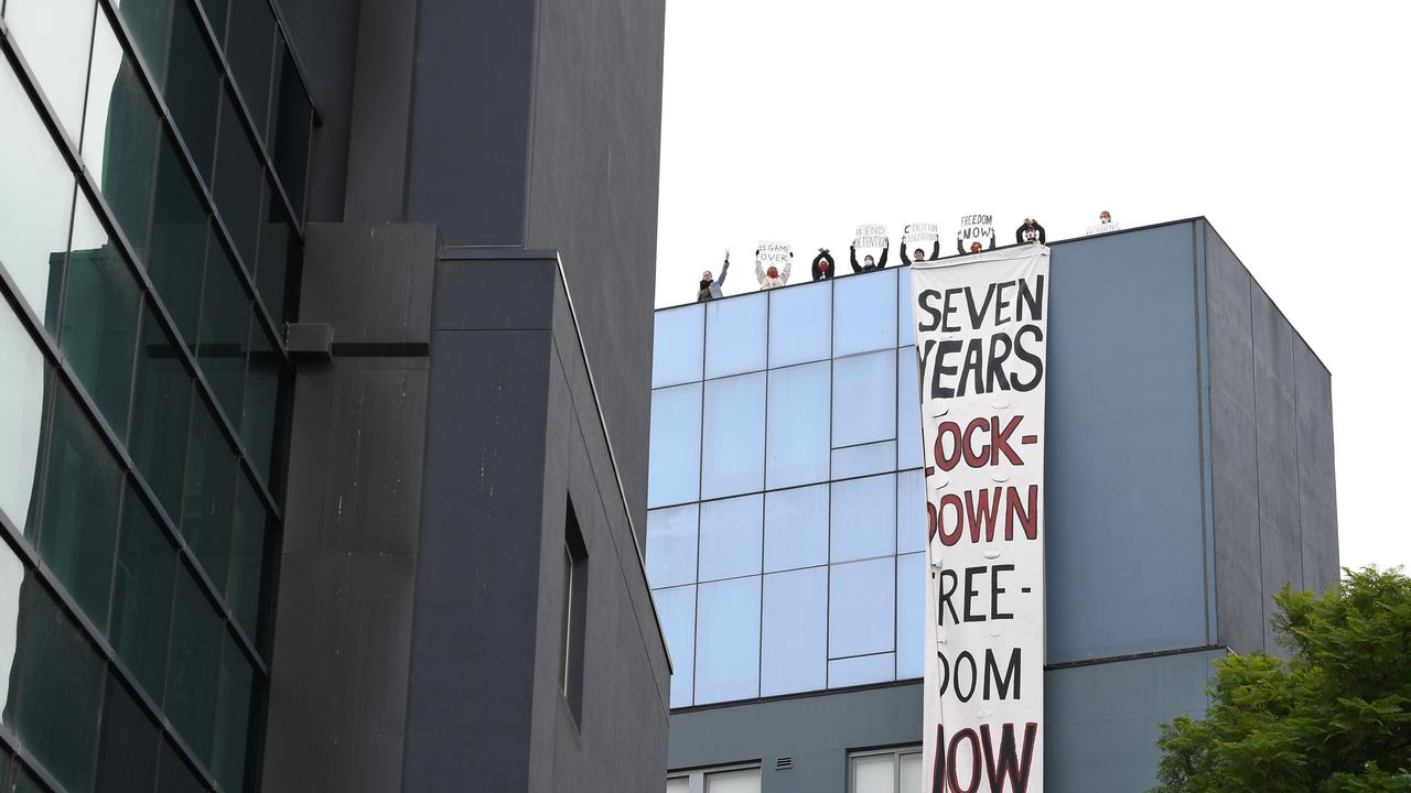 Protesters are seen on the roof of the Mantra Hotel in Preston. Picture: James Ross/AAP