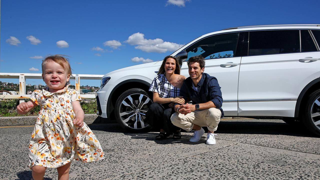 Matty J and partner Laura Byrne pictured with daughter Marlie-Mae and their Volkswagon Tiguan at Bondi. Picture: Toby Zerna