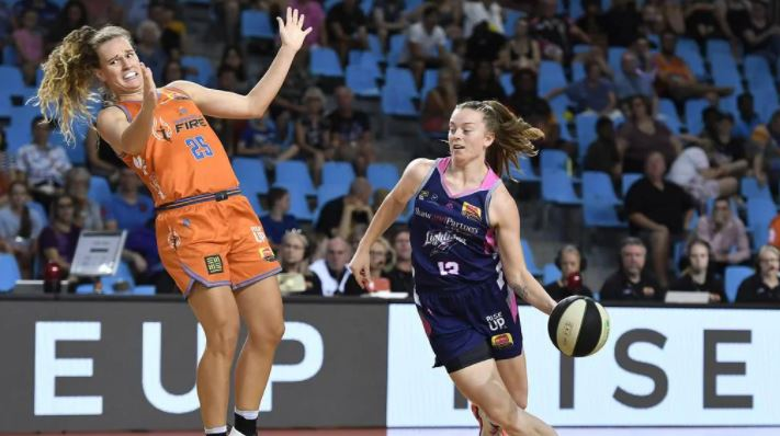 Abigail Wehrung of the Lightning gets past Megan McKay of the Fire during the round five WNBL match between the Townsville Fire and the Adelaide Lightning at Cairns Pop Up Arena, on December 11, 2020, in Cairns, Australia. (Photo by Albert Perez/Getty Images)