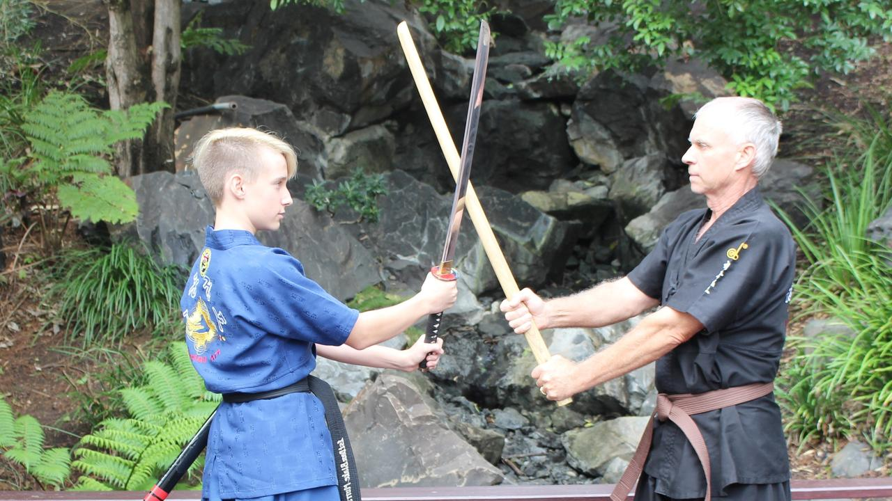 Ipswich father and son martial artists Derek (right) and Blake Murray.