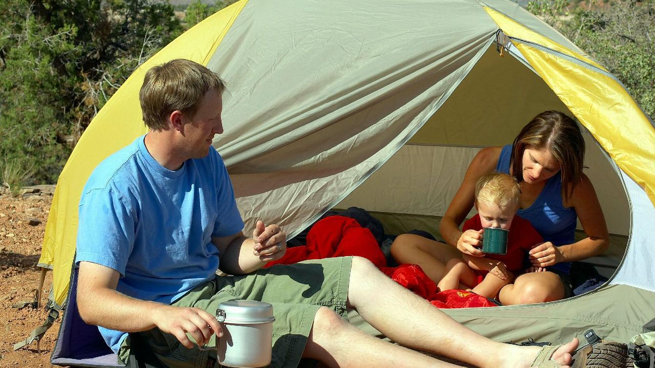 A family enjoys a camping adventure.