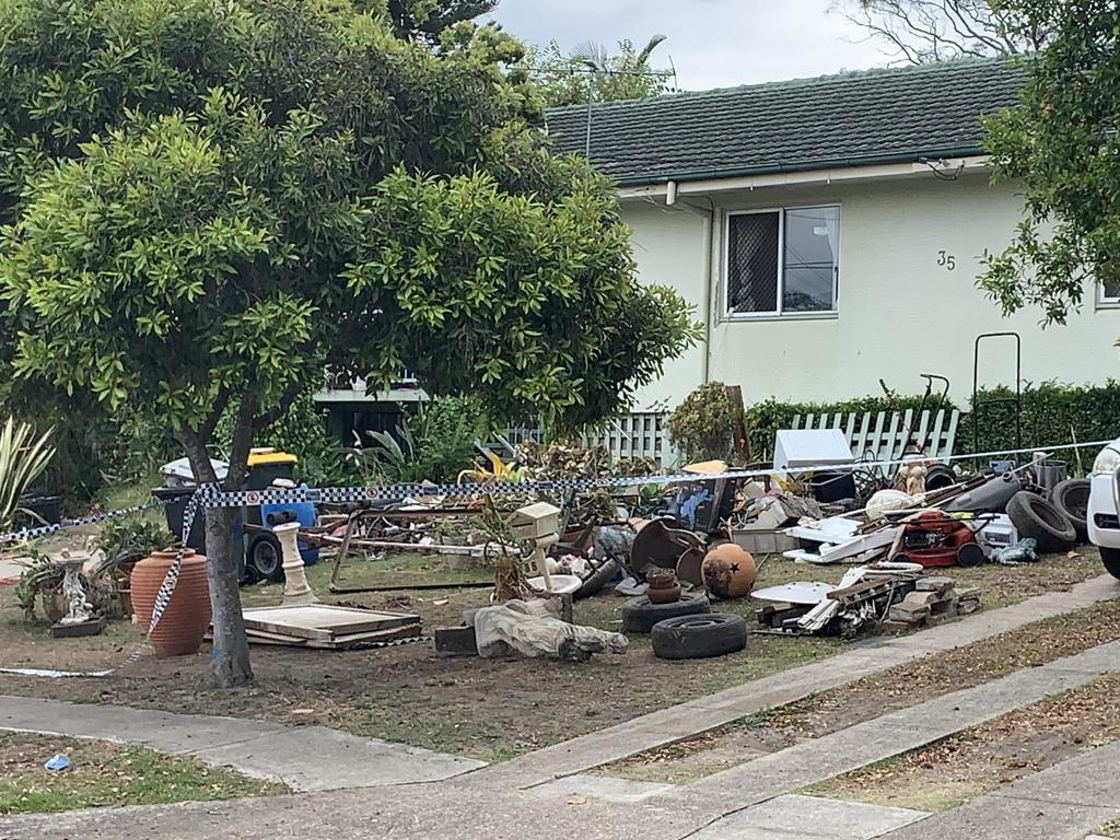 A mountain of miscellaneous items piled up in front of the Enrights' house.