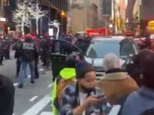 Car ploughs into protesters in NYC