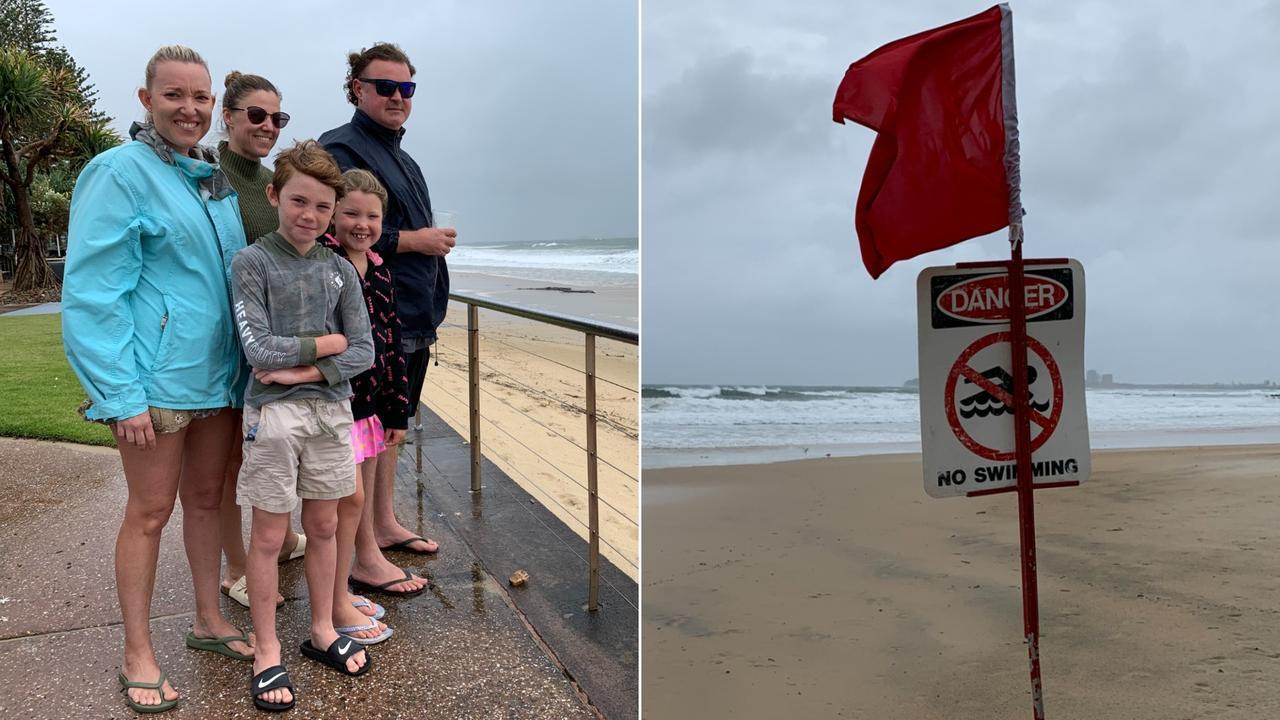 Surf lifesavers have closed Coast beaches due to the wild weather on Sunday. Kate Davis, Mandy Dunjey, Chase Dunjey, 9, Tamzin Davis, 8, and Aaron Davis check the surf at Alexandra Headland. Photo: Stuart Cumming