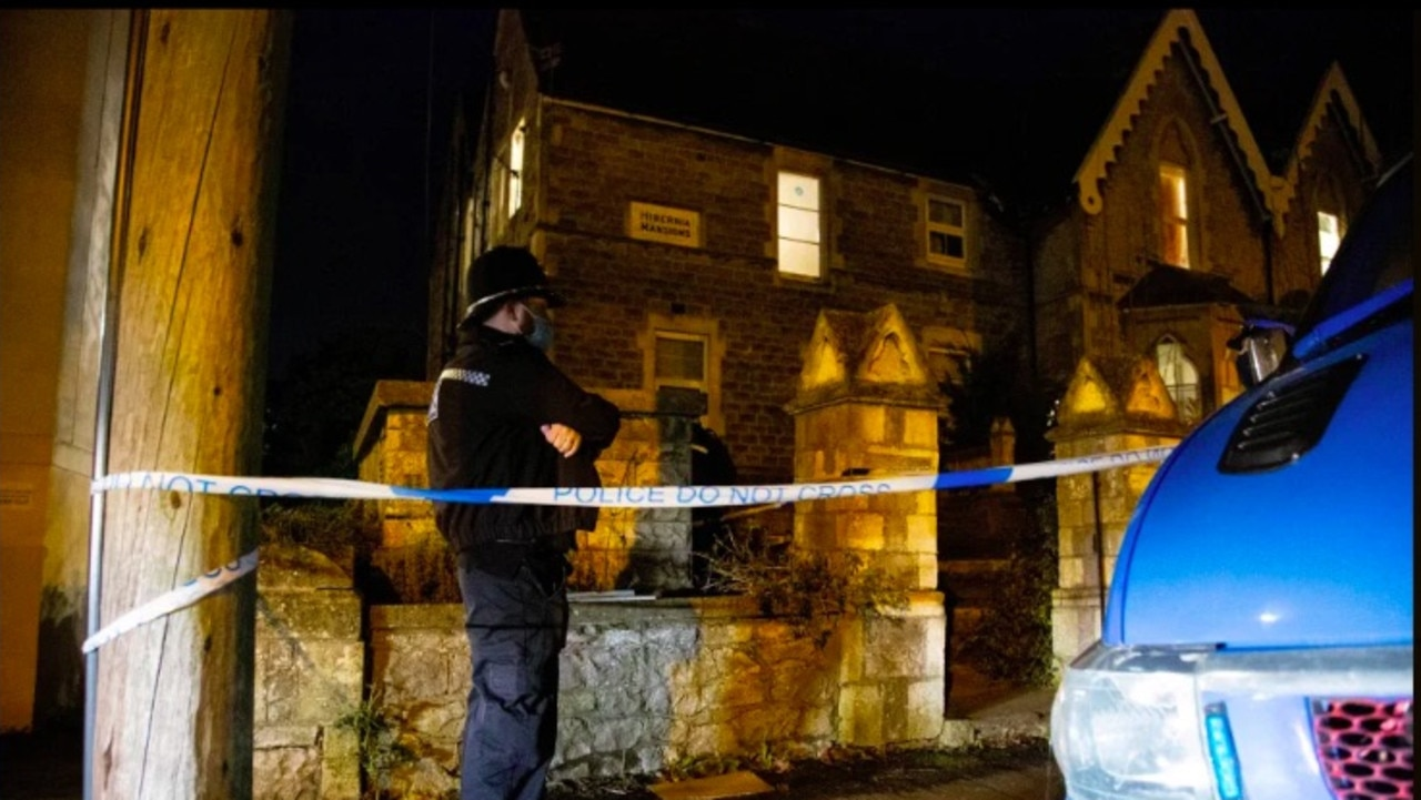 Police standing outside the house the baby was found in. Picture: Supplied