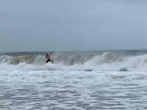 A surfer enjoys the waves at Mooloolaba Beach